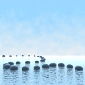 Harmony concept. Pebble path on the water over blue sky